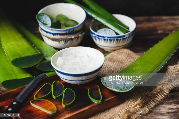 Close-Up Of Aloe Vera Slices With Bowls On Cutting Board