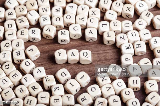 Close-Up Of Alphabet On Cubes At Table