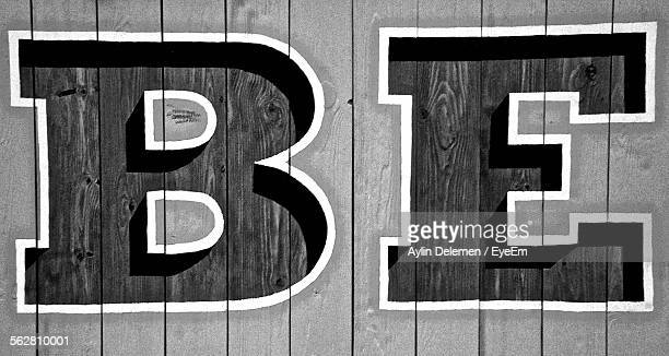Close-Up Of Alphabets On Wooden Planks