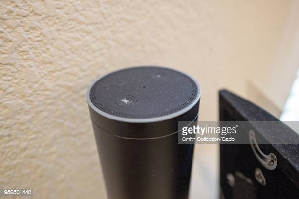 Closeup of Amazon Echo smart speaker and voice assistant which uses the Amazon service from Amazon to recognize and respond to users' voice commands...