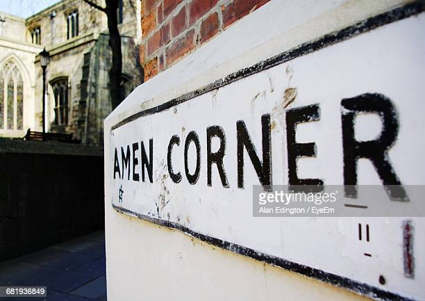 Close-Up Of Amen Corner Sign Near Church