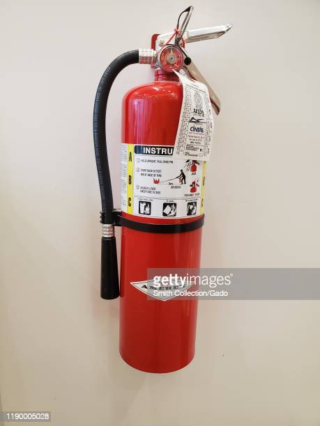 Close-up of Amerex fire extinguisher mounted on a wall in San Ramon, California, August 12, 2019.