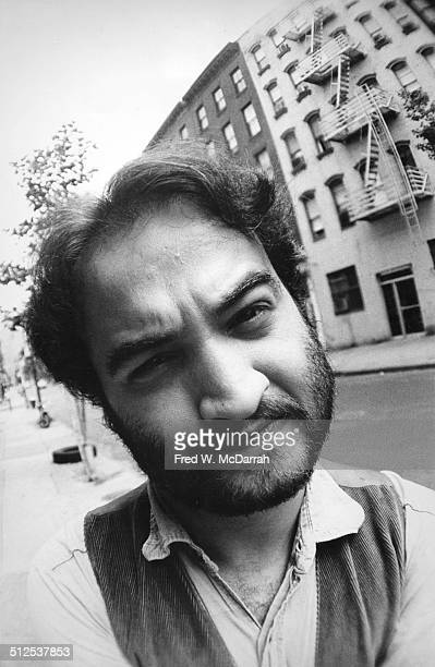 Closeup of American actor and comedian John Belushi as he poses on a sidewalk in Greenwich Village New York New York July 14 1975