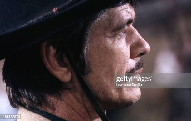 Closeup of American actor Charles Bronson in costume during the filming of 'Once Upon a Time in the West' Spain 1967