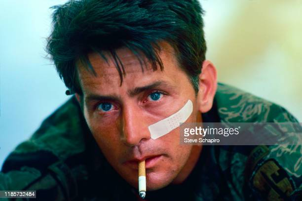 Close-up of American actor Martin Sheen, a cigarette in his mouth, on the set of his film, 'Apocalypse Now' , Philippines, 1978.