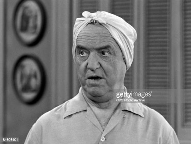 CLose-up of American actor William Frawley , as Fred Mertz, wears a scarf on his head in a scene from an episode of the television comedy 'I Love...