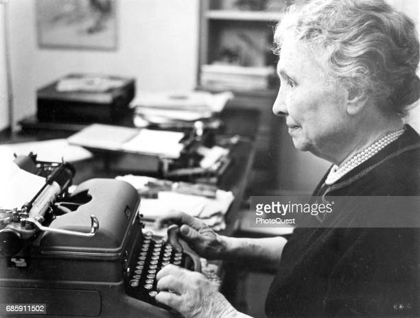 Closeup of American author and activist Helen Keller as she works at a typewriter in her home Connecticut 1954