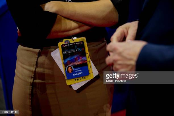 Closeup of American broadcast journalist Hallie Jackson's press pass as she stands on the floor of the Quicken Arena before the Republican National...
