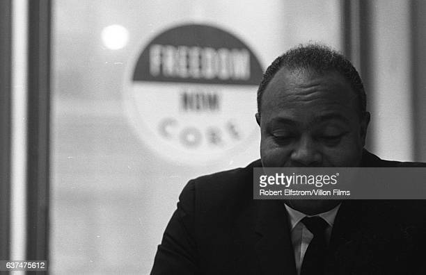 Closeup of American Civil Rights activist James Farmer Jr cofounder of the Congress of Racial Equality in his office New York 1964