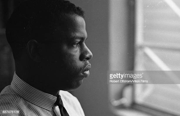 Close-up of American Civil Rights activist John Lewis, chairman of the Student Non-Violent Coordinating Committee , in an office, New York, 1964.
