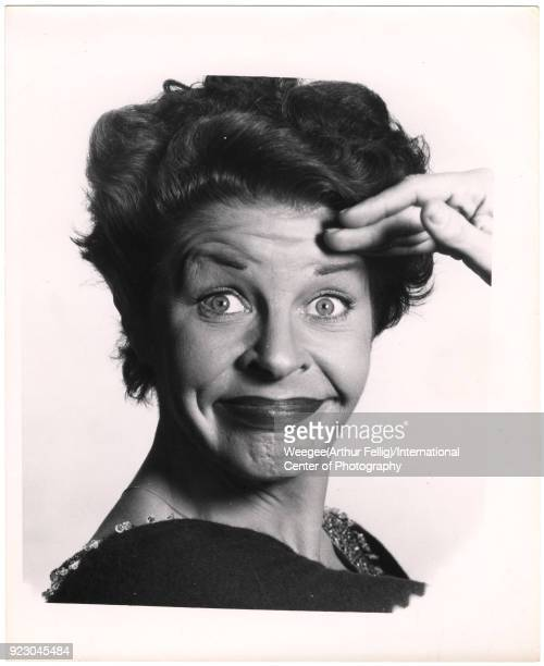 Closeup of American comedienne and actress Martha Raye as she makes a comic face against a white background twentieth century Photo by Weegee...