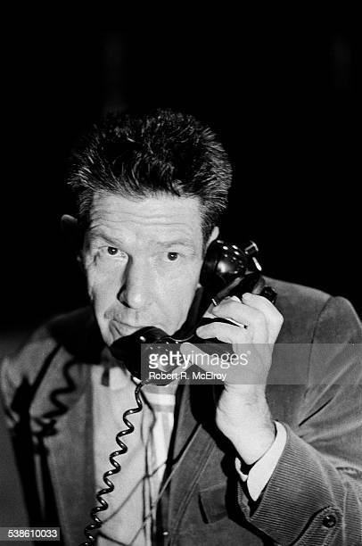 Closeup of American composer John Cage as he uses a telephone as part of his 'Variations VII' piece during '9 Evenings Theatre Engineering' at the...