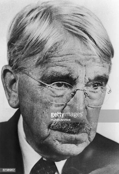 Closeup of American educator and philosopher John Dewey wearing wireframed glasses Dewey was a founder of the progressive education movement and The...