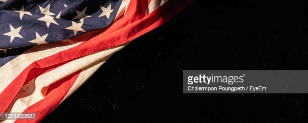 close-up of american flag against black background - stars and stripes stock pictures, royalty-free photos & images