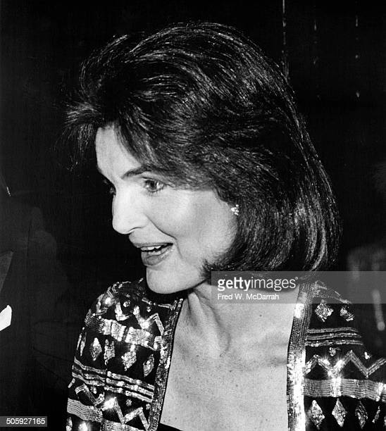 Closeup of American former First Lady Jacqueline Kennedy Onassis at a party to memorialize the life of author James Jones and the posthumous...