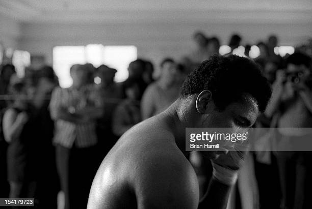 Closeup of American heavyweight boxer Muhammad Ali in the ring with supporters in the background during training at the 5th Street Gym Miami Florida...