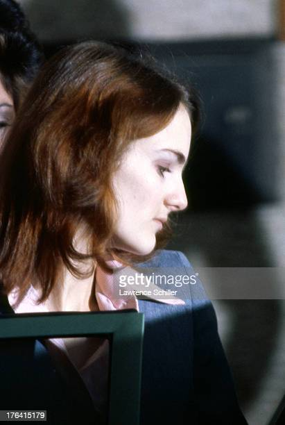 Close-up of American heiress Patty Hearst as she is escorted from her holding cell during her trial for her role in the robbery of the Sunset...