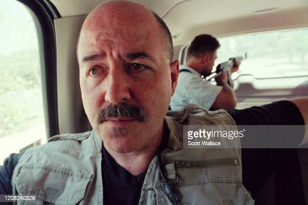 Close-up of American Interior Minister of the Iraqi Coalition Provisional Authority and former law enforcement official Bernard Kerik as he rides in...