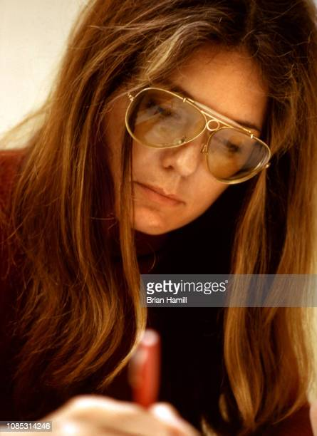 Closeup of American magazine publisher and political activist Gloria Steinem as she writes New York 1972