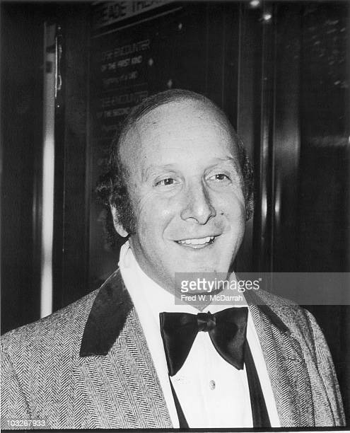 Closeup of American music executive Clive Davis as he attends the film prmeier of 'Close Encounters of the Third Kind' at the Ziegfield Theater New...