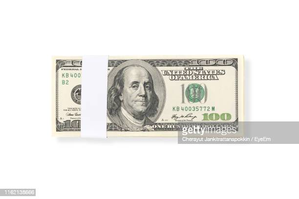 close-up of american one hundred dollar bill on white background - american one hundred dollar bill stock pictures, royalty-free photos & images
