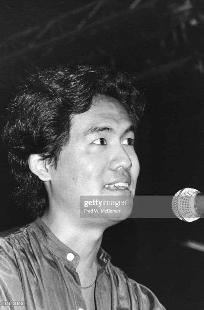 Close-up Of American playwright David Henry Hwang speaks into a microphone after winner the Obie Award for Best New American Play for his play 'F.O.B.' New York, New York, June 1, 1981.