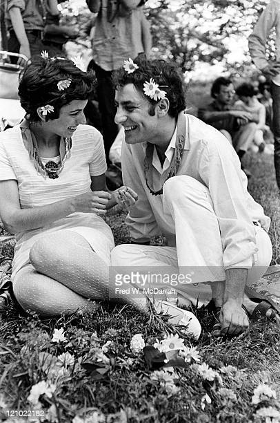 Closeup of American political and social activists Anita Kushner and Abbie Hoffman as they smile at one another during their wedding ceremony in...