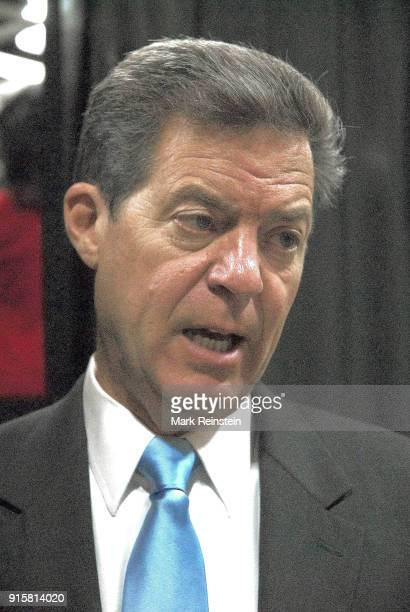 Closeup of American politician Kansas Governor Sam Brownback as he talks to the press at an election night party in the Capitol Plaza Hotel ballroom...