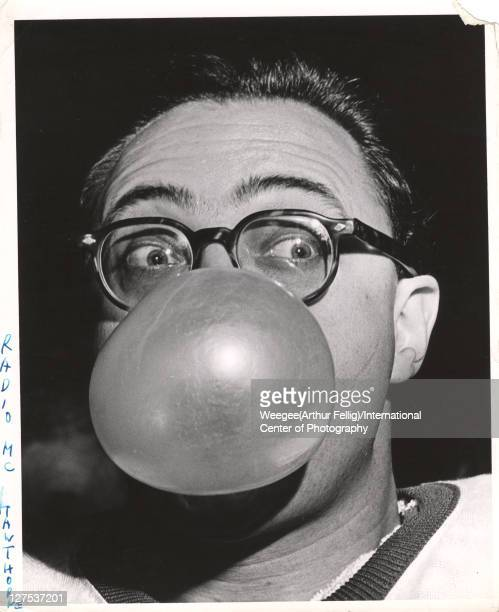 Closeup of American radio host and comedian Jim Hawthorne as he blows a large bubble with chewing gum his eyes wide open mid 20th century Photo by...