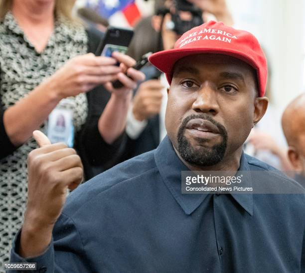 Closeup of American rapper and producer Kanye West in the White House's Oval Office Washington DC October 11 2018 He wears a red baseball cap that...