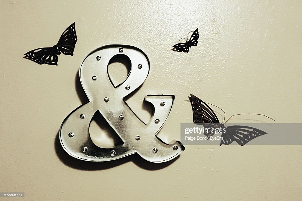 Closeup Of Ampersand Symbol With Artificial Butterflies On