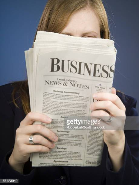close-up of an adult woman reading a newspaper - western script stock pictures, royalty-free photos & images