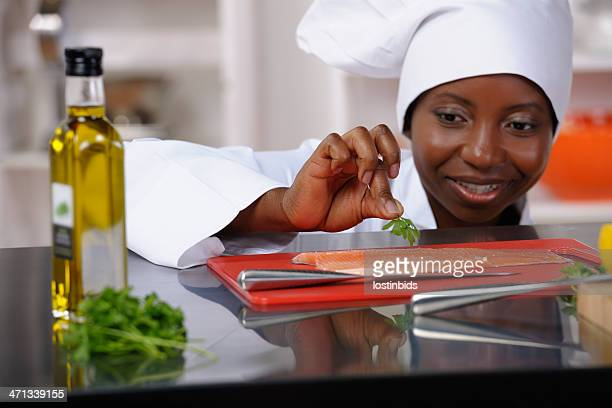 Close-up Of An African American Female Chef Preparing Fish