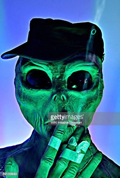 Close-up of an alien smoking a cigarette