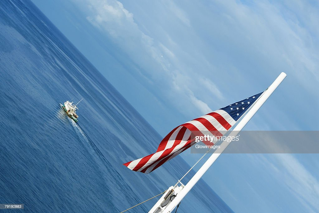 Close-up of an American flag fluttering : Foto de stock