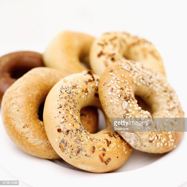 Close-up of an array of assorted bagels on a plate
