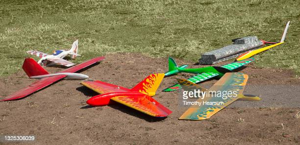 close-up of an array of colorful radio-controlled gliders on the ground - timothy hearsum stock-fotos und bilder