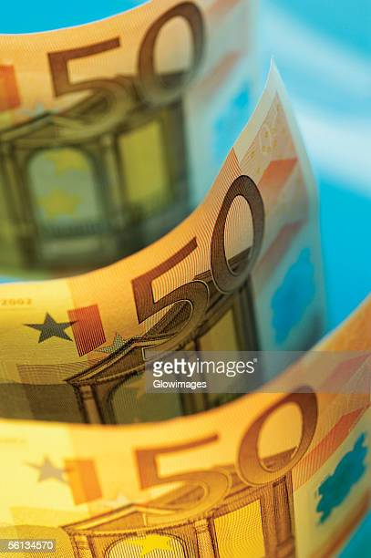 Close-up of an array of fifty Euro banknotes