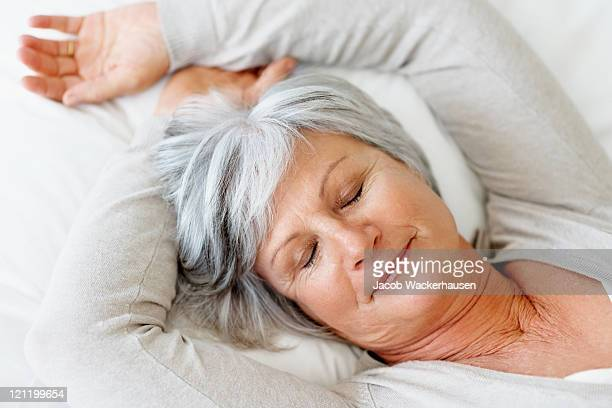 Closeup of an elderly woman fast asleep in bed