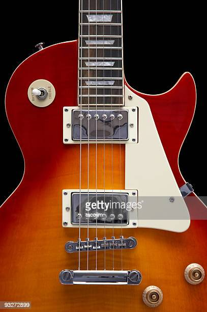 Close-up of an electric guitar on a white background