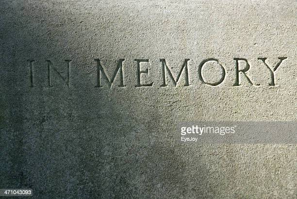 close-up of an engraving on a cement grave - etching stock pictures, royalty-free photos & images