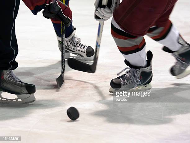 close-up of an ice hockey match - hockey puck stock pictures, royalty-free photos & images
