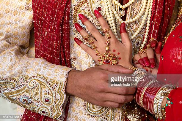 Close-up of an Indian bride and groom in traditional wedding dress