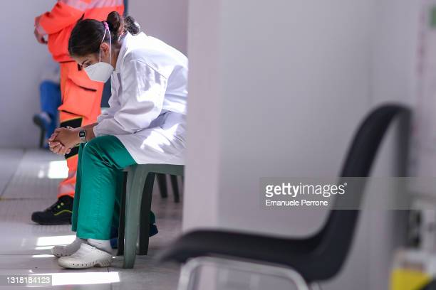 """Close-up of an Italian Army doctor resting during the """"Sardi e Vaccinati"""" vaccination campaign on the island of La Maddalena on May 15, 2021 in La..."""