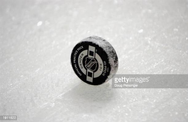 A closeup of an official NHL puck on the ice during the game between the Montreal Canadiens and the Philadelphia Flyers at First Union Center on...