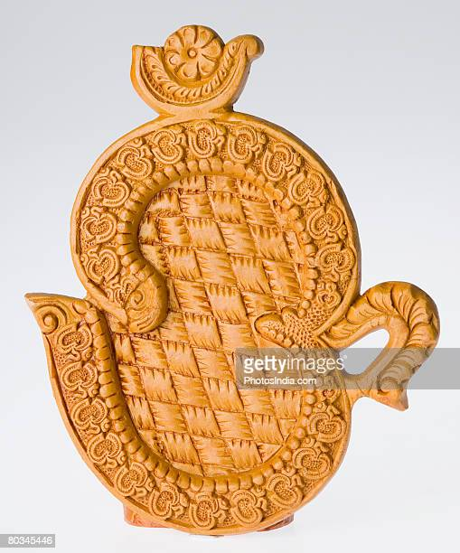 Close-up of an ohm symbol figurine