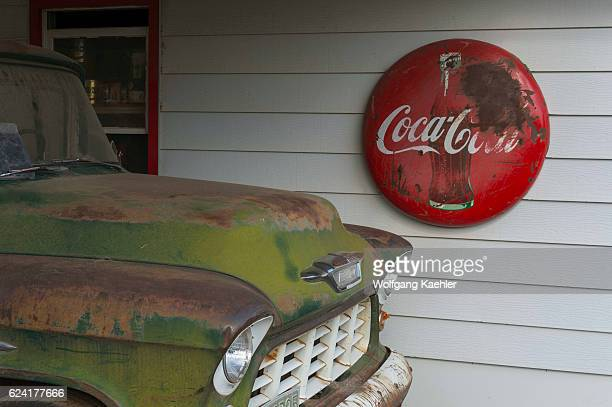 Closeup of an old Chevrolet car at an old gas station with a CocaCola sign part of an old car collection at a farm near Colfax in Whitman County in...