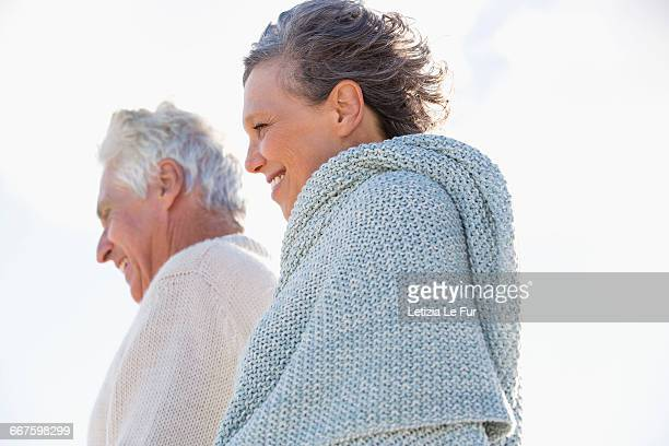 Close-up of an old couple smiling