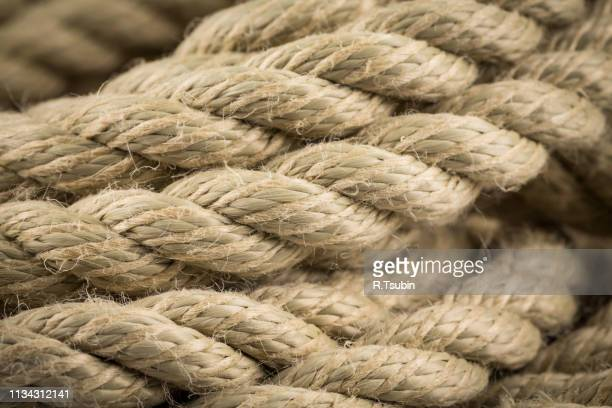 Close-up of an old frayed boat rope as a background