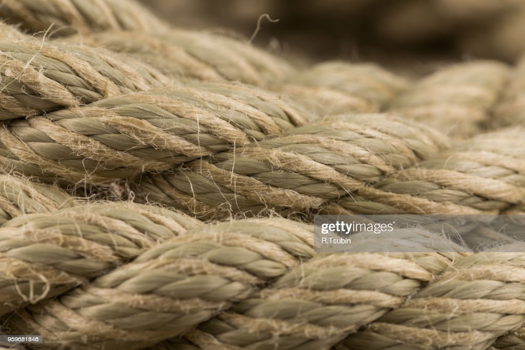 Close-up of an old frayed boat rope as a background : Foto de stock